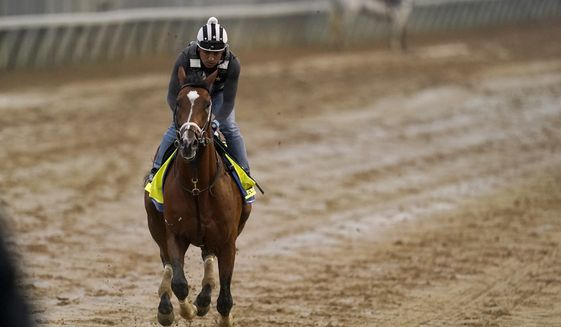 Kentucky Derby entrant Mandaloun works out at Churchill Downs Thursday, April 29, 2021, in Louisville, Ky. The 147th running of the Kentucky Derby is scheduled for Saturday, May 1. (AP Photo/Charlie Riedel) **FILE**