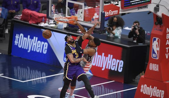 华盛顿巫师 forward Rui Hachimura (8) dunks against Los Angeles Lakers forward Anthony Davis (3) during the second half of an NBA basketball game, Wednesday, April 28, 2021, in Washington. (AP Photo/Nick Wass) **FILE**