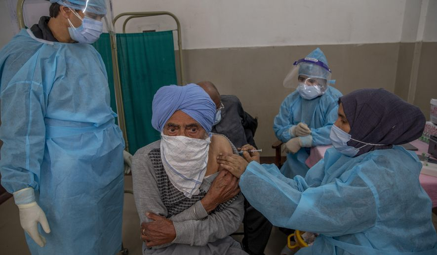 A Kashmiri man receives the COVISHIELD vaccine for COVID-19 at a primary health center in Srinagar, Indian controlled Kashmir, Wednesday, April 28, 2021. India, a country of nearly 1.4 billion people, Wednesday became the fourth nation to cross 200,000 deaths. (AP Photo/ Dar Yasin)