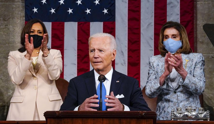 Vice President Kamala Harris and House Speaker Nancy Pelosi of Calif., stand and applaud as President Joe Biden addresses a joint session of Congress, Wednesday, April 28, 2021, in the House Chamber at the U.S. Capitol in Washington. (Melina Mara/The Washington Post via AP, Pool)