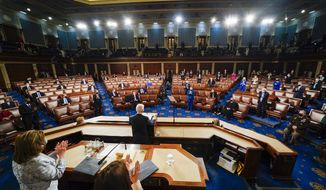 President Joe Biden addresses a joint session of Congress, Wednesday, April 28, 2021, in the House Chamber at the U.S. Capitol in Washington, as Vice President Kamala Harris and House Speaker Nancy Pelosi of Calif., stand and applaud. (Melina Mara/The Washington Post via AP, Pool)