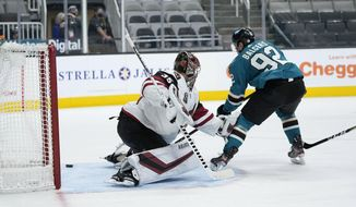 San Jose Sharks left wing Rudolfs Balcers (92) scores a goal past Arizona Coyotes goaltender Darcy Kuemper (35) during the first period of an NHL hockey game Wednesday, April 28, 2021, in San Jose, Calif. (AP Photo/Tony Avelar)