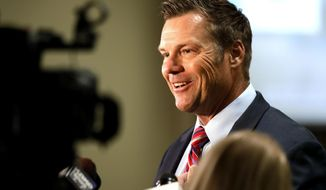 FILE - In this Aug. 4, 2020 file photo, Kris Kobach, a candidate for the Republican nomination for U.S. Senate, talks with reporters at his primary watch party in Leavenworth, Kan. Polarizing conservative Kris Kobach launched a campaign Thursday, April 29, 2021, for Kansas attorney general, attempting a political comeback in 2022 after losing nationally watched races for governor and U.S. Senate. (AP Photo/Orlin Wagner ,File)