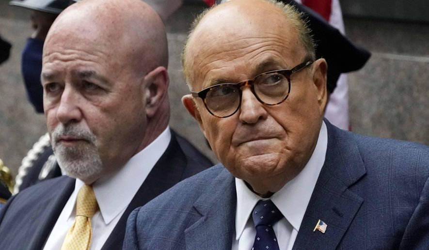 This photo from Friday Sept. 11, 2020, shows former New York Mayor Rudolph Giuliani, right, and former New York City Police Commissioner Bernard Kerik, left, during the Tunnel to Towers ceremony in New York. (AP Photo/Mark Lennihan, File)