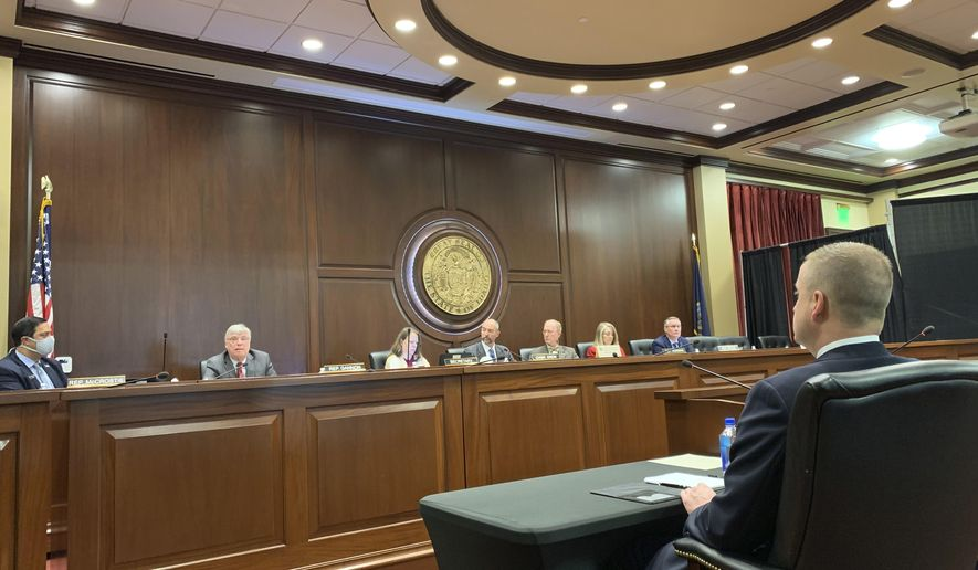 """Idaho state Rep. Aaron von Ehlinger, right, a Republican from Lewiston, watches as members of the House ethics committee discuss whether he acted in a way that was """"unbecoming"""" to his position in connection with rape allegations brought against him by a 19-year-old intern, during a hearing in Boise, Idaho, on Thursday, April 29, 2021. The committee unanimously agreed on Thursday that von Ehlinger should be formally censured and suspended from his office, and that a new lawmaker should be appointed to serve in his place. The full House could vote on the matter as soon as Friday. (AP Photo/Rebecca Boone)"""