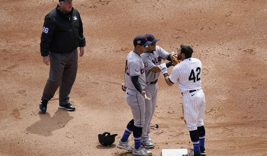 Cleveland Indians' second baseman Cesar Hernandez, left, and Indians shortstop Andres Gimenez, center, argue with Chicago White Sox's Adam Eaton at second base during the first inning of a baseball game in Chicago, Thursday, April 15, 2021. (AP Photo/Nam Y. Huh)