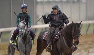 Kentucky Derby entrant Essential Quality is led off the track after a workout at Churchill Downs Thursday, April 29, 2021, in Louisville, Ky. The 147th running of the Kentucky Derby is scheduled for Saturday, May 1. (AP Photo/Charlie Riedel)