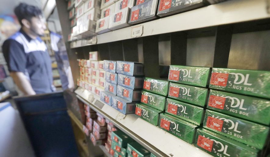 This May 17, 2018 file photo shows packs of menthol cigarettes and other tobacco products at a store in San Francisco. U.S. health regulators will announce a new effort Thursday, April 29, 2021, to ban menthol cigarettes, according to a Biden administration official. (AP Photo/Jeff Chiu, File)