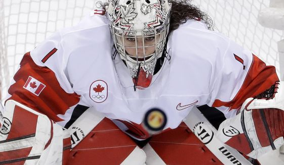 """FILE - In this Thursday, Feb. 22, 2018 file photo, goalie Shannon Szabados (1), of Canada, stares at the flying puck during the second period of the women's gold medal hockey game against the United States at the 2018 Winter Olympics in Gangneung, South Korea. Tyler Tumminia is leaving the door open should members of the Professional Women's Hockey Players' Association ever want to reach out to the National Women's Hockey League in a bid to thaw what's been a chilly relationship. PWHPA member and former Canadian national team goalie Shannon Szabados was skeptical. """"Until I see a league in North America that I would want my daughter to play in, my stance with the PWHPA remains united to create a better opportunity for future generations,"""" Szabados wrote in a text. (AP Photo/Matt Slocum, File)"""