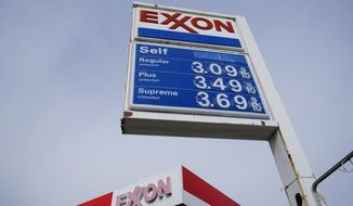 Gas prices are shown on an Exxon service station sign in Philadelphia, Wednesday, April 28, 2021. Commodities like plastic, paper, sugar and grains are all getting more expensive as demand outpaces supply. Companies are also paying more for shipping as fuel costs rise and ports experience longer delays because of congestion. (AP Photo/Matt Rourke) ** FILE **