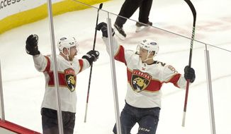 Florida Panthers Sam Bennett, left, celebrates his winning goal with Aleksi Heponiemi during the overtime period of an NHL hockey game against the Chicago Blackhawks, Thursday, April 29, 2021, in Chicago. (AP Photo/Charles Rex Arbogast)