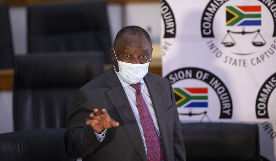 South African President Cyril Ramaphosa appears on behalf of the ruling African National Congress party at the Zondo Commission of Inquiry into state corruption in Johannesburg, South Africa, Thursday, April 29, 2021. Ramaphosa says rampant corruption has seriously damaged South Africa's economy and people's trust in the government. (Kim Ludbrook/Pool via AP)