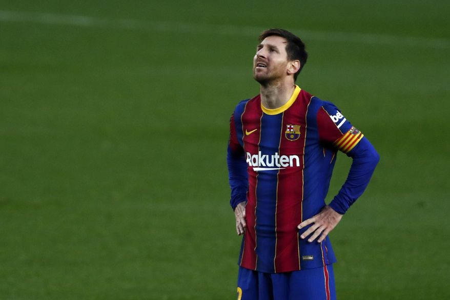 Barcelona's Lionel Messi reacts after a missed scoring opportunity during the Spanish La Liga soccer match between FC Barcelona and Granada at the Camp Nou stadium in Barcelona, Spain, Thursday, April 29, 2021. (AP Photo/Joan Monfort)