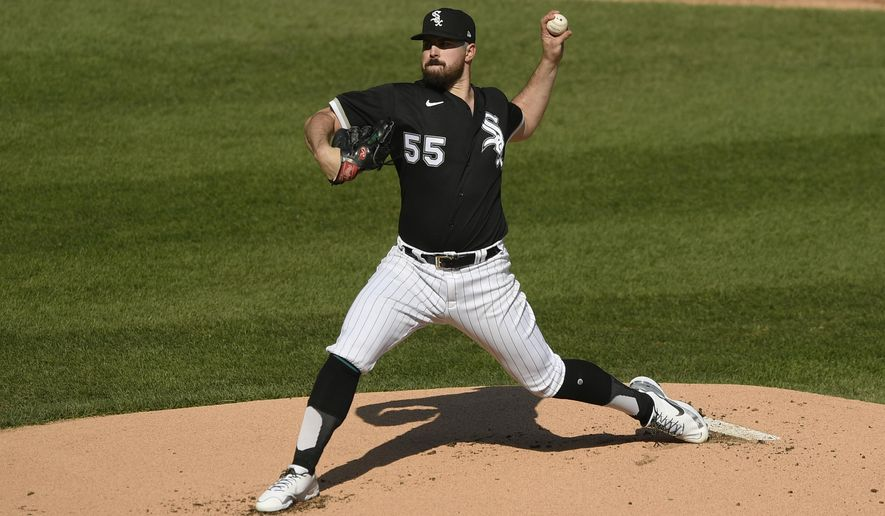 Chicago White Sox starter Carlos Rodon delivers a pitch during the first inning of the first baseball game of a doubleheader against the Detroit Tigers, Thursday, April 29, 2021, in Chicago. (AP Photo/Paul Beaty)