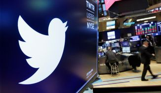 In this Feb. 8, 2018, file photo, the logo for Twitter is displayed above a trading post on the floor of the New York Stock Exchange. (AP Photo/Richard Drew, File)