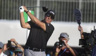 Phil Mickelson tees off on the first day of the PGA Valspar Championship golf tournament in Palm Harbor, Fla., Thursday, April 29, 2021. (John Pendygraft/Tampa Bay Times via AP)
