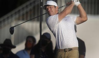 Paul Casey tees off on the first day of the PGA Valspar Championship golf tournament in Palm Harbor, Fla., Thursday, April 29, 2021. (John Pendygraft/Tampa Bay Times via AP)