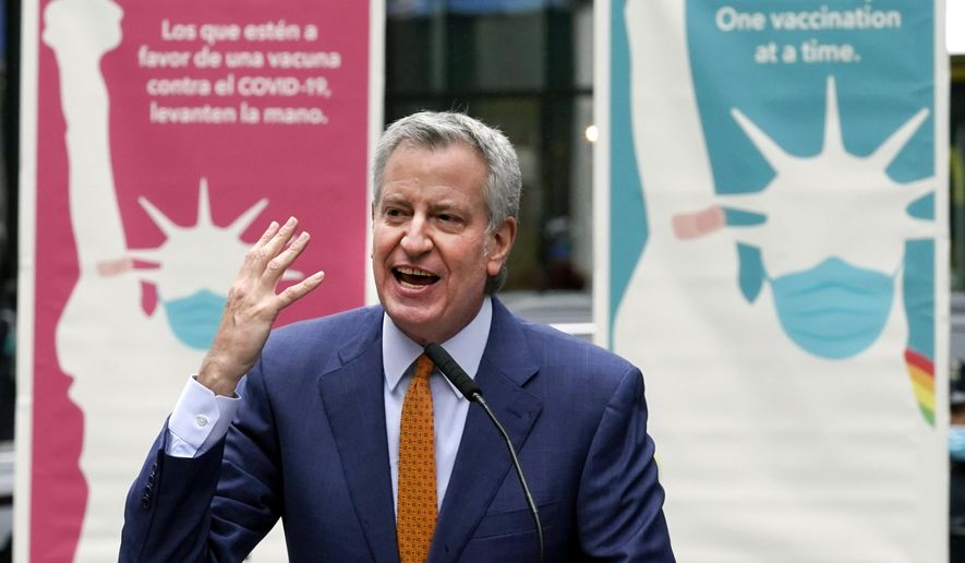 In this Monday, April 12, 2021, file photo, New York Mayor Bill de Blasio delivers remarks in Times Square after he toured the grand opening of a Broadway COVID-19 vaccination site intended to jump-start the city's entertainment industry, in New York. (AP Photo/Richard Drew) ** FILE **