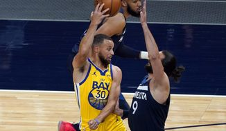 Golden State Warriors' Stephen Curry (30) passes the ball as Minnesota Timberwolves' Ricky Rubio (9) defends in the first half of an NBA basketball game, Thursday, April 29, 2021, in Minneapolis. (AP Photo/Jim Mone)