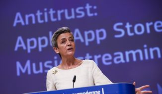 European Commissioner for Europe fit for the Digital Age Margrethe Vestager speaks during an online news conference on Apple anti trust case at the EU headquarters in Brussels, Friday, April 30, 2021. European Union regulators are accusing Apple of violating the bloc's antitrust laws, alleging that the company distorts competition for music streaming through rules for its App Store. (AP Photo/Francisco Seco, Pool)