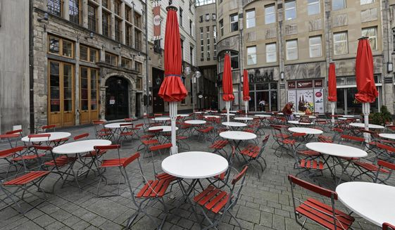FILE - In this March 18, 2021 file photo, empty tables are seen on a deserted square in normally very busy old town of Cologne, Germany, Thursday. The European Union statistics agency Eurostat announces first-quarter growth figures for the 19 countries that use the euro. (AP Photo/Martin Meissner)