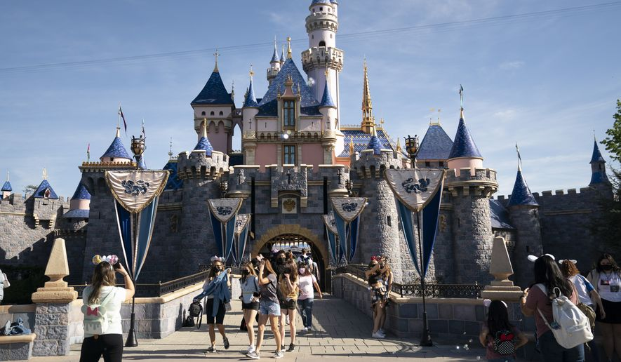 The Sleeping Beauty Castle is seen at Disneyland in Anaheim, Calif., Friday, April 30, 2021. The iconic theme park in Southern California that was closed under the state's strict virus rules swung open its gates Friday and some visitors came in cheering and screaming with happiness. (AP Photo/Jae C. Hong)