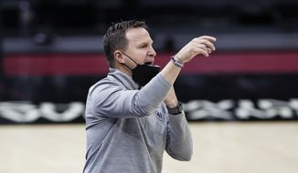 Washington Wizards head coach Scott Brooks signals to his team against the Cleveland Cavaliers during the second half of an NBA basketball game, Friday, April 30, 2021, in Cleveland. (AP Photo/Ron Schwane) **FILE**