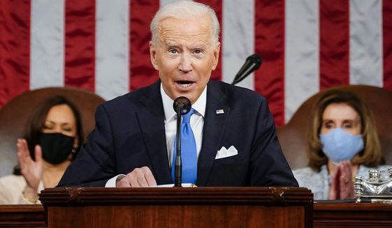 President Joe Biden addresses a joint session of Congress, Wednesday, April 28, 2021, in the House Chamber at the U.S. Capitol in Washington, as Vice President Kamala Harris, left, and House Speaker Nancy Pelosi of Calif., applaud. (Melina Mara/The Washington Post via AP, Pool)