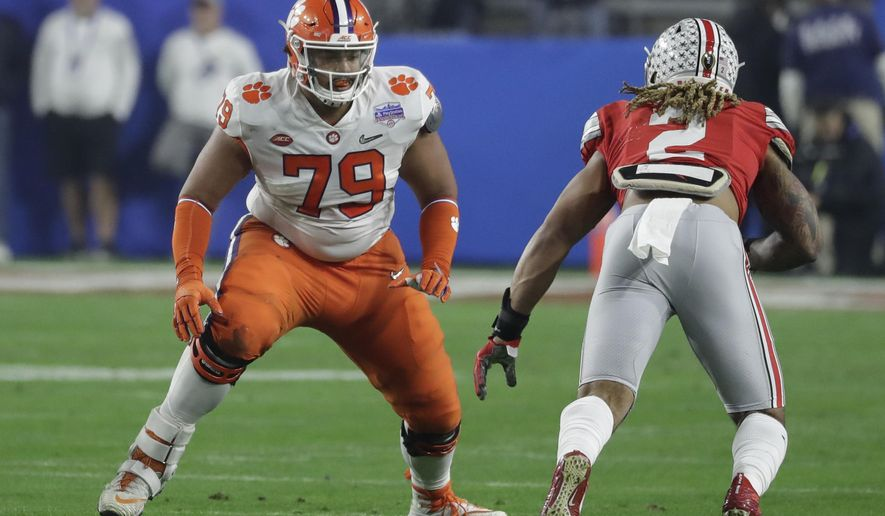 FILE - In this Dec. 28, 2019, file photo, Clemson offensive tackle Jackson Carman (79) looks to block during the first half of the Fiesta Bowl NCAA college football game against Ohio State in Glendale, Ariz. The Cincinnati Bengals got some help for their offensive line Friday night, taking Carman with their second-round pick in the NFL draft. (AP Photo/Rick Scuteri, File)