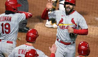 St. Louis Cardinals' Matt Carpenter, top right, returns to the dugout after hitting a three-run home run off Pittsburgh Pirates relief pitcher Duane Underwood Jr. during the sixth inning of a baseball game in Pittsburgh, Friday, April 30, 2021. (AP Photo/Gene J. Puskar)
