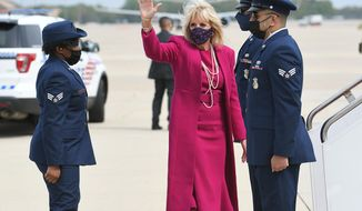 First lady Jill Biden makes her way to board a plane before departing from Andrews Air Force Base, Md., Wednesday, April 21, 2021. Biden is traveling to New Mexico and Arizona. (Mandel Ngan/ Pool via AP)