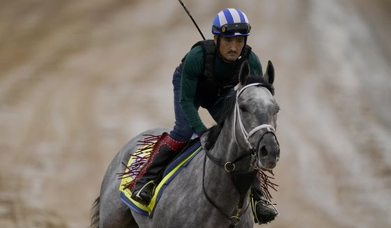 Kentucky Derby entrant Essential Quality works out at Churchill Downs Thursday, April 29, 2021, in Louisville, Ky. The 147th running of the Kentucky Derby is scheduled for Saturday, May 1. (AP Photo/Charlie Riedel)