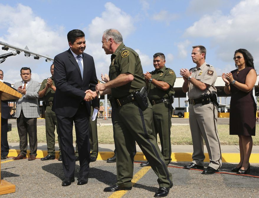 FILE - In this June 7, 2018 file photo, U.S. Border Patrol Sector Chief for the Rio Grande Valley Manuel Padilla Jr., center, shakes hands with Tamaulipas Gov. Francisco Garcia Cabeza de Vaca, during a news conference at the Hidalgo-Reynosa International Bridge in Hidalgo, Texas. Mexico's congress voted Friday, April 30, 2021, to impeach Garcia Cabeza de Vaca on charges of tax evasion, money laundering and organized crime. (Nathan Lambrecht/The Monitor via AP File)