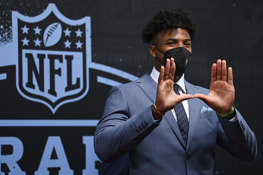 Miami edge rusher Gregory Rousseau appears on the red carpet at the Rock & Roll Hall of Fame before the NFL football draft Thursday, April 29, 2021, in Cleveland. (AP Photo/David Dermer, Pool)