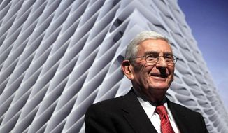 In this Thursday, Jan. 6, 2011, file photo, Billionaire Eli Broad attends the unveiling of the Broad Art Foundation contemporary art museum designs in Los Angeles. Eli Broad, the billionaire philanthropist, contemporary art collector and entrepreneur who co-founded homebuilding pioneer Kaufman and Broad Inc. and launched financial services giant SunAmerica Inc., died Friday, April 30, 2021 in Los Angeles. He was 87.  (AP Photo/Jae C. Hong, File)