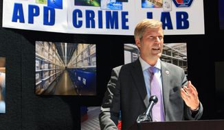 Albuquerque Mayor Tim Keller discusses the city's efforts to end a backlog for testing rape evidence kits during a news conference in Albuquerque, N.M., Friday, April 30, 2021. Keller said the city now has processes in place and teams of law enforcement officials and advocates working together to ensure another backlog never happens. (AP Photo/Susan Montoya Bryan)