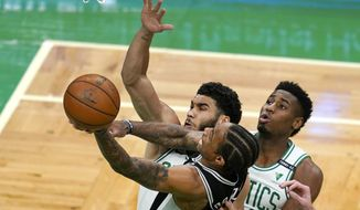 San Antonio Spurs forward DeMar DeRozan (10) drives to the basket against the defense of Boston Celtics forwards Jayson Tatum, left, and Aaron Nesmith during the first half of an NBA basketball game Friday, April 30, 2021, in Boston. (AP Photo/Elise Amendola)