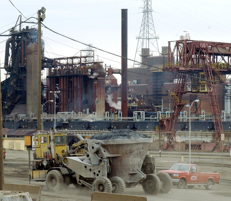 FILE - In this Dec. 4, 2003 file photo, heavy machinery rolls through the U.S Steel Corp. Edgar Thompson Works in Braddock, Pa., east of Pittsburgh. Pittsburgh-based United States Steel Corp. said Friday, April 30, 2021, that it is canceling a $1.5 billion project to bring state-of-the-art improvements to its operations in western Pennsylvania, saying the world has changed in the two years since it announced its intentions.  (AP Photo/Keith Srakocic, File)