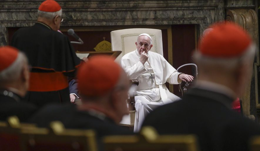 FILE - In this Dec. 21, 2019 file photo, Pope Francis listens to Cardinal Angelo Sodano, standing at left with back to camera, as he delivers his speech on the occasion of the pontiff's Christmas greetings to the Roman Curia, in the Clementine Hall at the Vatican. Pope Francis sent another chilling message to Vatican-based cardinals on Friday about his intent to hold them accountable for criminal misconduct, removing the legal obstacles that had prevented them from ever being prosecuted by the Vatican's criminal tribunal. (AP Photo/Andrew Medichini, Pool)