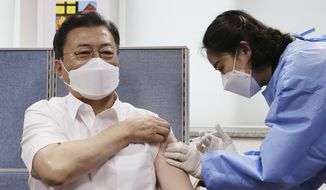 South Korean President Moon Jae-in, left, receives his second dose of the AstraZeneca COVID-19 vaccine at a health care center in Seoul, South Korea, Friday, April 30, 2021. (Lee Jin-wook/Yonhap via AP)