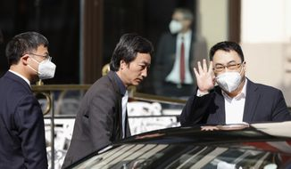"""The ambassador of the Permanent Mission of the People's Republic of China to the United Nations, Wang Qun, leaves the """"Grand Hotel Wien"""" where closed-door nuclear talks with Iran take place in Vienna, Austria, Saturday, May 1, 2021. (AP Photo/Lisa Leutner)"""