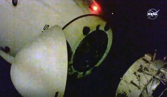 This image from video provided by NASA shows the SpaceX capsule as it departs the International Space Station, Saturday, May 1, 2021. A SpaceX capsule carrying four astronauts departed the International Space Station late Saturday, aiming for a rare nighttime splashdown to end the companys second crew flight. (NASA via AP)