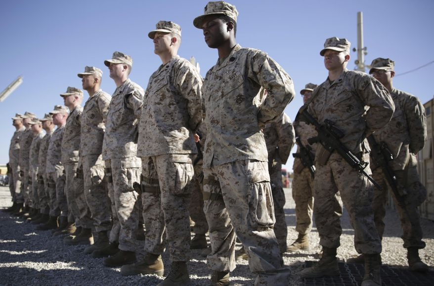 In this Jan. 15, 2018, photo, U.S. Marines watch during the change of command ceremony at Task Force Southwest military field in Shorab military camp of Helmand province, Afghanistan. (AP Photo/Massoud Hossaini) **FILE**