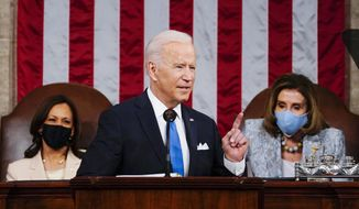 In this April 28, 2021, file photo President Joe Biden addresses a joint session of Congress in the House Chamber at the U.S. Capitol in Washington, as Vice President Kamala Harris, left, and House Speaker Nancy Pelosi of Calif., look on. (Melina Mara/The Washington Post via AP, Pool) ** FILE **