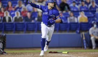 Toronto Blue Jays' Randal Grichuk celebrates after driving in the winning run with a single against the Atlanta Braves during the 10th inning of a baseball game Saturday, May 1, 2021, in Dunedin, Fla. The Blue Jays won 6-5. (AP Photo/Mike Carlson)