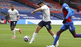 Manchester City's Sergio Aguero scores his team's first goal during the English Premier League soccer match between Crystal Palace and Manchester City at Selhurst Park in London, England, Saturday, May 1, 2021. (AP Photo/Catherine Ivill/Pool)