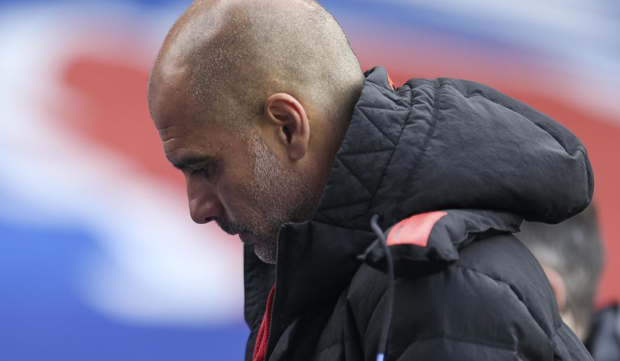 Manchester City's head coach Pep Guardiola walks from the pitch at halftime of the English Premier League soccer match between Crystal Palace and Manchester City at Selhurst Park in London, England, Saturday, May 1, 2021. (AP Photo/Steve Paston/Pool)