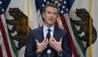 FILE - In this Jan. 8, 2021, file photo, California Gov. Gavin Newsom outlines his 2021-2022 state budget proposal during a news conference in Sacramento, Calif. The California Democratic Party is gathering for its annual convention on the heels of a recall against Newsom reaching the signature threshold to qualify for the ballot.   (AP Photo/Rich Pedroncelli, Pool, File)