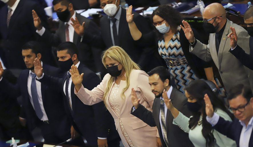 New members of the New Ideas party are sworn in during the Legislative Assembly in San Salvador, El Salvador, Saturday, May 1, 2021. (AP Photo/Salvador Melendez)