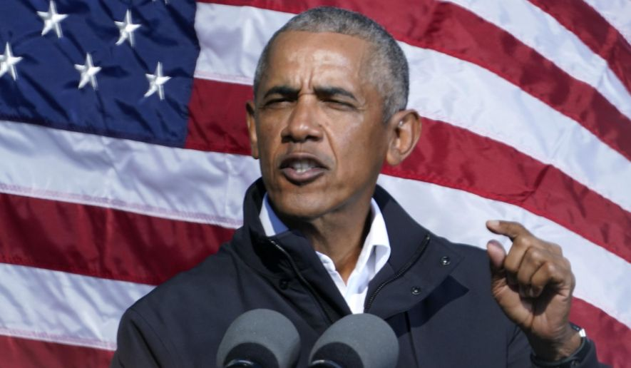 """FILE - In this Nov. 2, 2020 file photo, former President Barack Obama speaks at a rally as he campaigns for Democratic presidential candidate former Vice President Joe Biden in Atlanta.  A long-time patron of independent bookstores Obama celebrated Independent Bookstore Day by virtually """"stopping in"""" to visit with six independent bookstores from around the country: Square Books of Oxford; Eso Won Books of Los Angeles, Calif.; Politics & Prose Bookstore of Washington, D.C.; Parnassus Books of Nashville, Tenn.; The Lit.Bar of Bronx, N.Y.; and Literati of Ann Arbor, Mich. Booksellers from each store spoke with the President about their mutual love of reading, the craft of writing, and all things books.  (AP Photo/Brynn Anderson, File)"""
